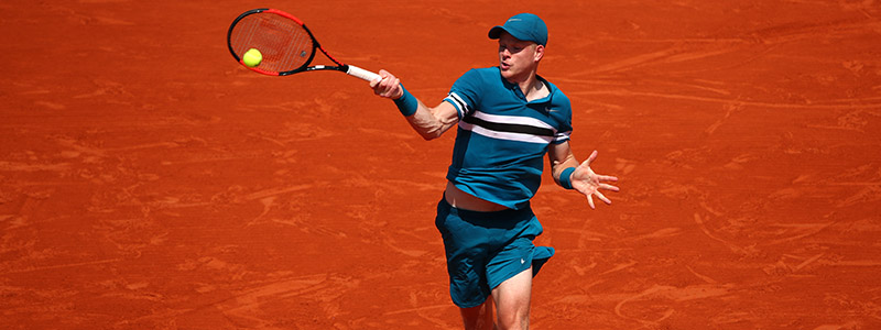 Kyle Edmund plays a forehand during the 2018 French Open