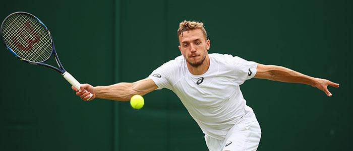 Alex Ward plays a forehand at Wimbledon