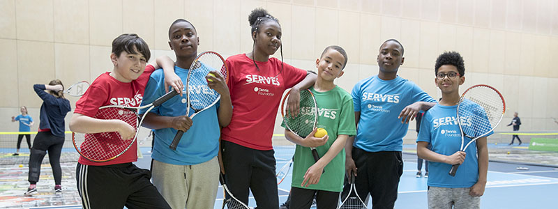 Kids take part at a SERVES Tennis Festival