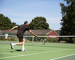 Man reaches for a forehand