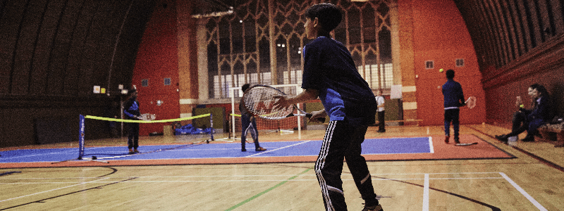 Boy playing tennis during a SERVES session